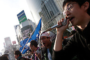 Yohei Sakano student activist with Zengakuren (All Japan Federation of Students' Autonomous Body) speaks into a microphone at an anti-war and left wing demonstration in Shibuya, Tokyo, Japan Saturday March 20th 2010