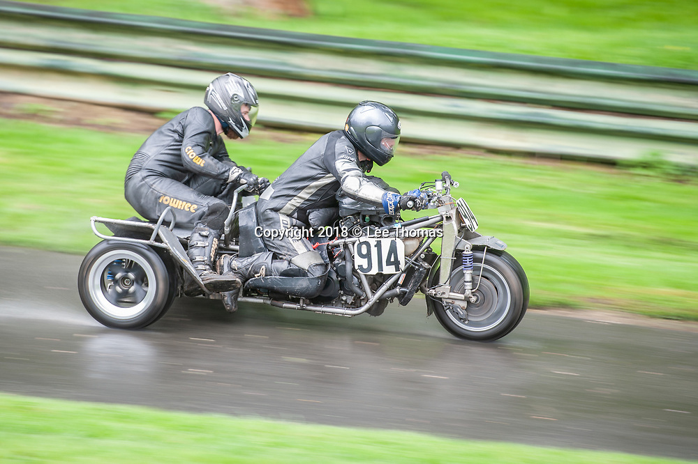 Prescott Hill, Gotherington, Cheltenham, Gloucestershire, UK. 28th April 2018.  Pictured:  A motorcycle sidecar team speed on a very wet Prescott Hill track. /  Some of the fastest hillclimb cars in the country braved April showers to compete in the opening round of the UK's premier championships at the historic Prescott Hill in Gloucestershire, home of the UK's Bugatti Owners' Club.  The two day event features the opening rounds of the British & Midland Hillclimb Championships as well as rounds for the Bugatti Owners' Club (BOC) New Barn Roadgoing and the Aldon Classic Championships. The weekend meeting also entertained hundreds of spectators with an appearance from the National Hill Climb Association (NHCA) motorcycles, several with attached sidecars.  //Lee Thomas, Tel. 07784142973. Email: leepthomas@gmail.com  www.leept.co.uk (0000635435)