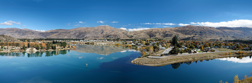 spectacular panoramic of cromwell and its mirror lake in the foreground and mountain scene behind, cromwell, new zealand