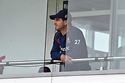 Ryan ten Doeschate of Essex out from the team balcony during the delay the start of play after a heavy rain shower this morning ahead of the Specsavers County Champ Div 1 match between Somerset County Cricket Club and Essex County Cricket Club at the Cooper Associates County Ground, Taunton, United Kingdom on 26 September 2019.
