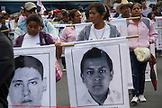 Relatives and friends of the forty-three missing students taking Mexico City streets in a protest
