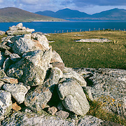 A cairn on top of a coastal hill overlooking the sound of Taransay, South Harris, Scotland