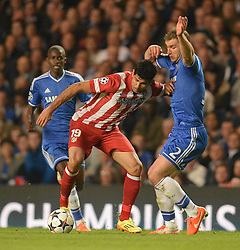 30.04.2014, Stamford Bridge, London, ENG, UEFA CL, FC Chelsea vs Atletico Madrid, Halbfinale, Rueckspiel, im Bild Athletico Madrid's forward Diego Costa holds off a challenge from Chelsea's defender Branislav Ivanovic // Athletico Madrid's forward Diego Costa holds off a challenge from Chelsea's defender Branislav Ivanovic during the UEFA Champions League Round of 4, 2nd Leg Match between Chelsea FC and Club Atletico de Madrid at the Stamford Bridge in London, Great Britain on 2014/05/01. EXPA Pictures © 2014, PhotoCredit: EXPA/ Mitchell Gunn<br /> <br /> *****ATTENTION - OUT of GBR*****
