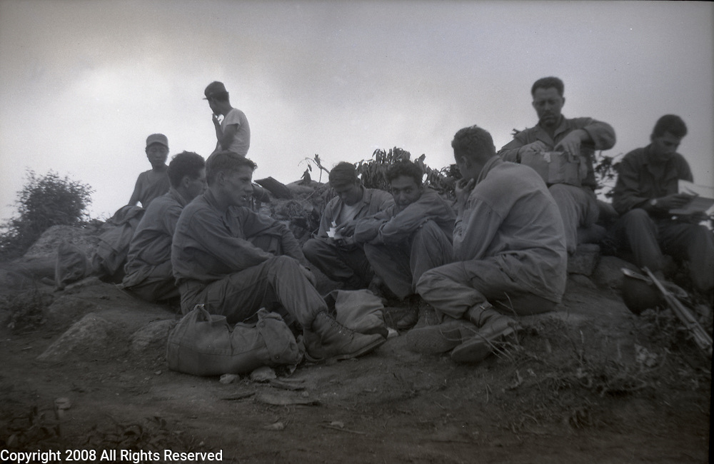 Two war weary members of the U.S. Army, Second Division relax at the unit's command post during the Korean War. Members of the 2nd Infantry Division during the Korean War in 1950 or 1951.
