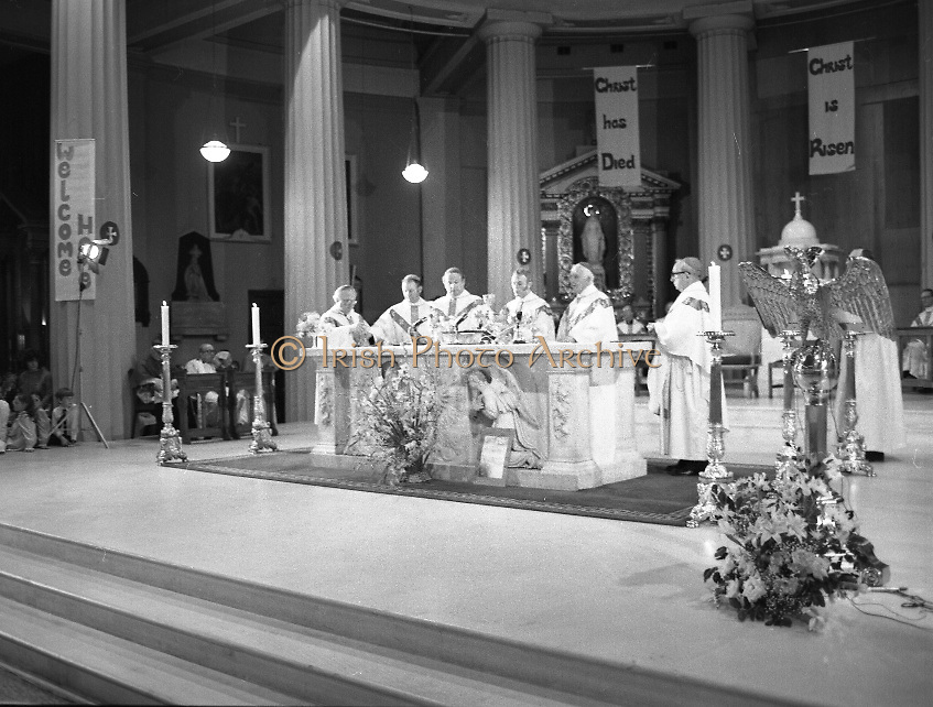 """Fr Niall O'Brien Returns from Captivity.1984..14.07.1984..07.14.1984..On 6 May 1983,Fr Niall O'Brien was arrested along with two other priests, Fr. Brian Gore, an Australian, Fr. Vicente Dangan, a Filipino and six lay workers - the so-called """"Negros Nine"""", for the murders of Mayor Pablo Sola of Kabankalan and four companions. The priests where held under house arrest for eight months but """"escaped"""" to prison in Bacolod City, the provincial capital, where they felt they would be safer.The case received widespread publicity in Ireland and Australia, the home of one of the co-accused priests, Fr. Brian Gore. When Ronald Reagan visited Ireland in 1984, he was asked on Irish TV how he could help the missionary priest's situation. A phone call the next day from the Reagan administration to Ferdinand Marcos resulted in Marcos offering a pardon to Fr. O'Brien and his co-accused..(Ref Wikipedia)...Image shows Fr Niall  O'Brien leading the ceremony in the Pro-Cathedral."""