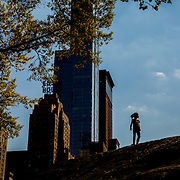 NEW YORK, NY - MAY 4, 2015: Kids walk atop a rock in Central Park near Columbus Circle. CREDIT: Sam Hodgson for The New York Times
