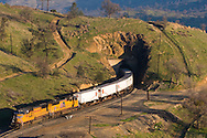 Popping out of Tunnel 10 in the Tehachapi Mountains, a southbound Union Pacific intermodal train greets the early morning sun.