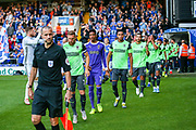 AFC Wimbledon come on to the pitch during the EFL Sky Bet League 1 match between Ipswich Town and AFC Wimbledon at Portman Road, Ipswich, England on 20 August 2019.