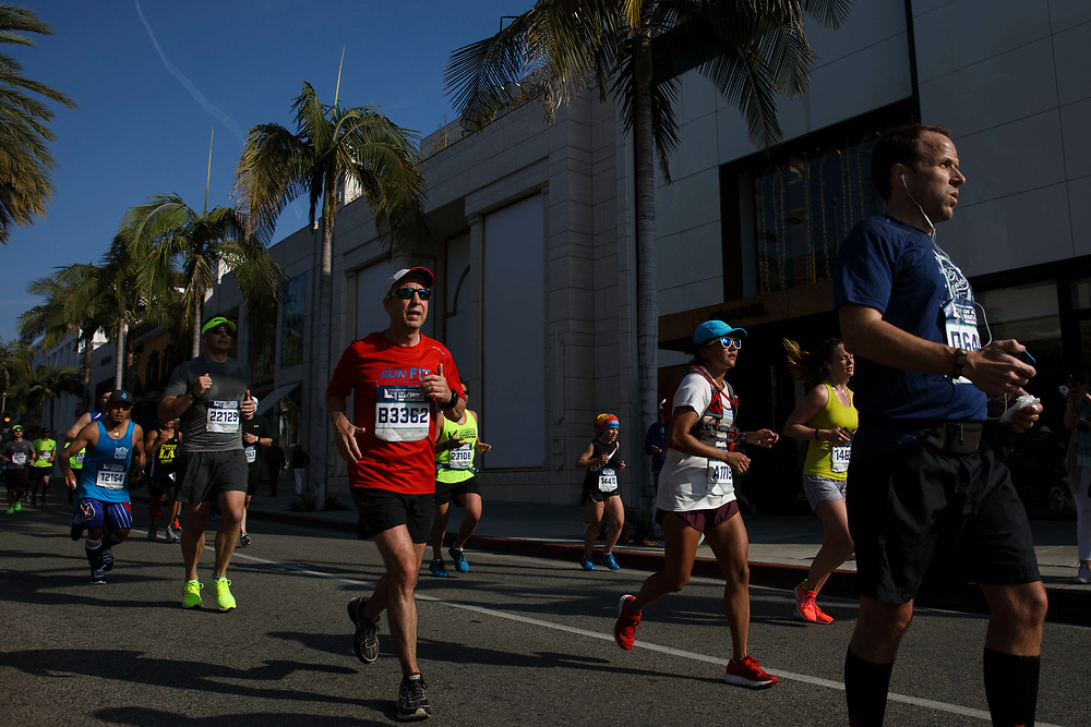 "Runners travel down Rodeo Drive near mile marker 17 during the 32nd annual Los Angeles Marathon on Sunday morning, March 19, 2017 in Beverly Hills, Calif.  The 26.2-mile ""Stadium to the Sea"" route begins at Dodger Stadium and ends at Ocean and California avenues in Santa Monica. © 2017 Patrick T. Fallon"