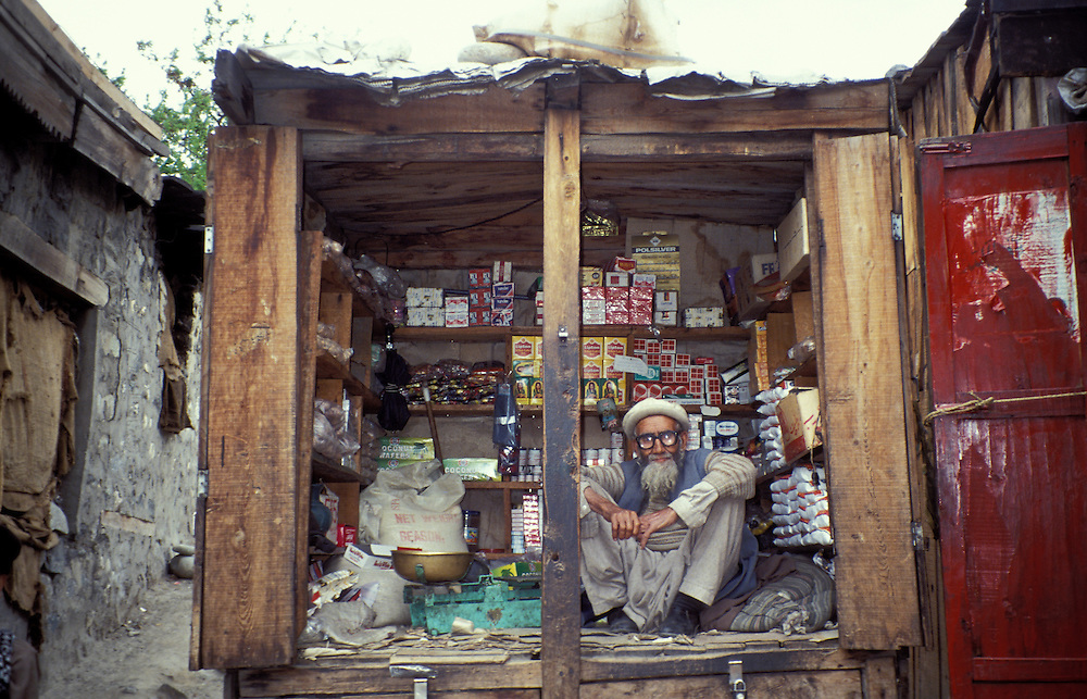 Man sitting in his local Mini shop in Skardu, Baltistan, Eastern Pakistan, Asia