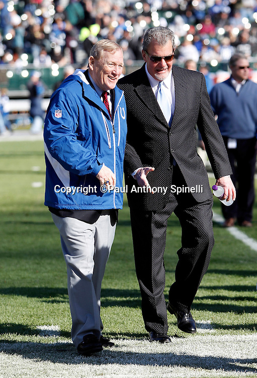 Indianapolis Colts President Bill Polian (left) walks off the field with Indianapolis Colts Owner and CEO James irsay after pregame warmups during the NFL week 16 football game against the Oakland Raiders on Sunday, December 26, 2010 in Oakland, California. The Colts won the game 31-26. (©Paul Anthony Spinelli)