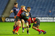 George Taylor (#13) of Edinburgh Rugby is tackled by Tertius Kruger (#12) of Isuzu Southern Kings during the Guinness Pro 14 2018_19 rugby match between Edinburgh Rugby and Isuzu Southern Kings at the BT Murrayfield Stadium, Edinburgh, Scotland on 5 January 2019.