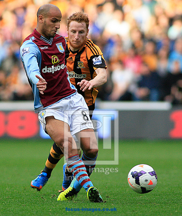 Picture by Richard Gould/Focus Images Ltd +44 7855 403186<br /> 05/10/2013<br /> Stephen Quinn (back) of Hull City can't get round Karim El Ahmadi of Aston Villa during the Barclays Premier League match at the KC Stadium, Kingston upon Hull.