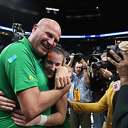 March 31, 2019; Portland, OR, USA;  Oregon Ducks head coach Kelly Graves hugs Oregon Ducks guard Sabrina Ionescu (20) after the Ducks defeated 88-84 in the Elite Eight of the NCAA Women's Tournament at Moda Center.<br /> Photo by Jaime Valdez