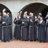 ASSISI, ITALY - OCTOBER 04:  Franciscans wave as Pope Francis leaves S Damiano Sancutary on October 4, 2013 in Assisi, Italy.  Pope Francis is due to venerate the tomb of San Francesco of Assisi at the crypt of the Upper Basilica of Saint Francis tomorrow during his one-day visit to the city.  (Photo by Marco Secchi/Getty Images)