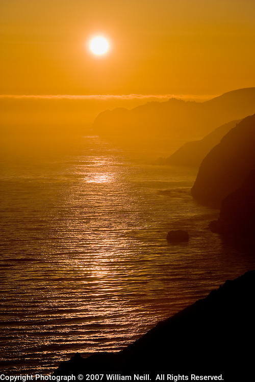 Sunset over Pacific Ocean and coast, Big Sur, California