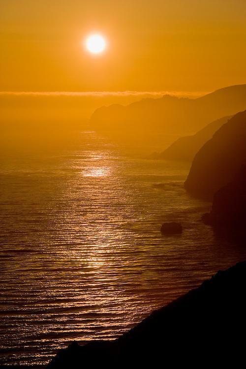 Sunset over Pacific Ocean and coast, Big Sur, California