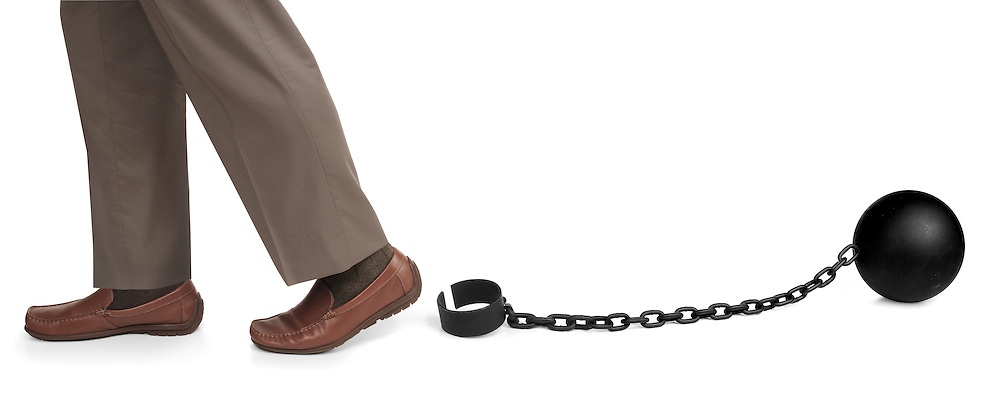 man's legs released from ball and chain