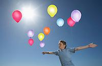 Boy Releasing Balloons