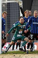 27.04.2006, Veritas Stadion, Turku, Finland..Veikkausliiga 2006 - Finnish League 2006.FC Inter Turku - Tampere United.Ville Lehtinen (TamU) v Henri Lehtonen, Ari Nyman & Jukka Sinisalo (Inter).©Juha Tamminen.....ARK:k