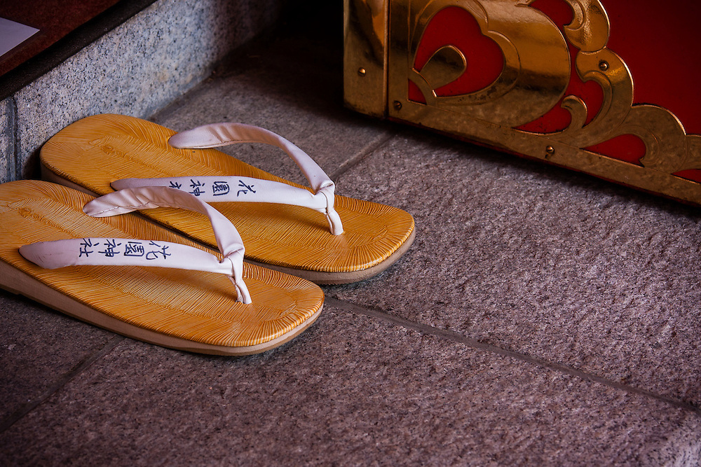 A pair of flip flop slippers waits for its owner outside Zenkoji Temple, in the middle of Tokyo's Shinjuku district.