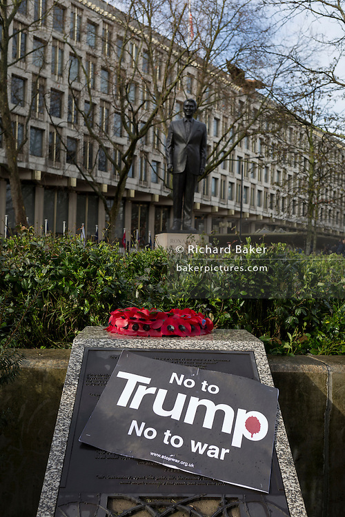 Detail of a war memorial and the statue of Ronald Reagan outside the London US Embassy at the Stop Trump's Muslim ban demonstration on 4th February 2017 in London, United Kingdom. The protest was called on by Stop the War Coalition, Stand Up to Racism, Muslim Association of Britain, Muslim Engagement and Development, the Muslim Council of Britain, CND and Friends of Al-Aqsa. Thousands of demonstrators gathered to demonstrate against Trump's ban on Muslims, saying it must be opposed by all who are against racism and support basic human rights, and for Theresa May not to collude with him.