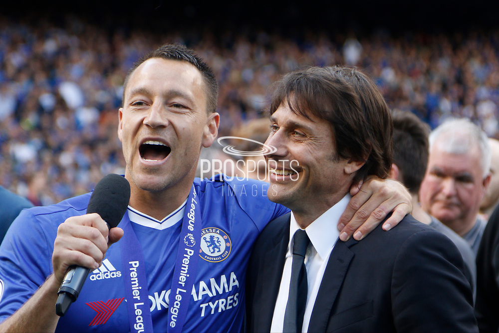 Chelsea Defender John Terry (26) and Chelsea Manager Antonio Conte sing together during the Premier League match between Chelsea and Sunderland at Stamford Bridge, London, England on 21 May 2017. Photo by Andy Walter.