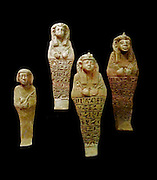Shabti (Faience figures) from a Pyramid tomb in Egypt. The figures are from left to right: Queen Maleteral 643-623 BC, Queen Nasalsa 593-568 BC, Queen Madiken 593-568 BC, and Queen Artaha 593-568 BC