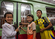 EXCLUSIVE<br /> The Pyongyang subway<br /> The best place to escape american fire and fury<br /> <br />  Built in 1970s, Pyongyang Metro may soon become the best place for north koreans to escape &laquo; fire and the fury like the world has never seen &raquo; that promises Donal Trump. It includes only 17 stations on two lines, with a total length of 30 km. In Seoul it is about 300 km. Construction of the metro service began in 1968 and was inaugurated in 1973 by Kim Il Sung, the grandfather of Kim Jong Un.  Before entering the platform, one must purchase a ticket and go through the checkpoint. The fare is cheap, only 5 wons, half of a US cent.<br /> You have to validate your ticket at one of these automatic machines. But they did not work the day I visited. Instead, a train attendant checked was checking the tickets by hand.  Like in so many others places, the visits of the Dear Leaders are immortalized by a red billboard telling the date they visited the place.<br /> So you will learn Kim Il Sung used this escalator. You can also find out what he has done in his life, as the North korean propaganda set up a billboard every time<br /> they visited a place.  There are only 2 metro lines, so getting lost is not easy.<br /> Each station is named after the revolution: Comrade, Red Star, Glory, Liberation, Signal Fire, Rehabilitation, Victory, Paradise, Restoration... not named after places though.  Going down the 120 meters takes just few seconds but you feel like being in a movie as the revolutionary music and patriotic songs are played all around from the loudspeakers.<br /> Everybody stays at his/her place, no one tries to jump the queue.<br /> &copy;Eric lafforgue/Exclusivepix media