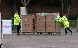 SERCO staff move equipment at a drive through coronavirus testing site in a car park at Chessington World of Adventures, in Greater London, as the UK continues in lockdown to help curb the spread of the coronavirus.