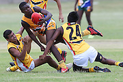 POTCHEFSTROOM, SOUTH AFRICA - JANUARY 28, Moni Yonela (WC Magpies) of the SA Lions is caught by Callum AhChee (Armadale, WA) and Elijah Howard (Waterford, WA) of the Australian Boomerangs  during the AFL Game 1 match between the Flying Boomerangs and South African Lions under 18's at Mohadin Cricket Ground on January 28, 2013 in Potchefstroom, South Africa.Photo by Roger Sedres / Image SA