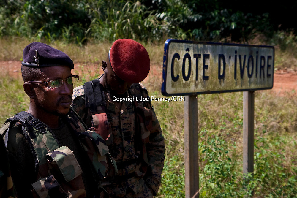 Soldiers from the New Forces Ivorian rebel group supporting<br /> Alassane Ouattara patrol Ivory Coast's border with Guinea, December<br /> 15, 2010. Nearly 4,000 refugees fro Ivory Coast have fled into<br /> neighboring Guinea and Liberia in the past two weeks, and Guinea has<br /> stepped up its security at the borders.