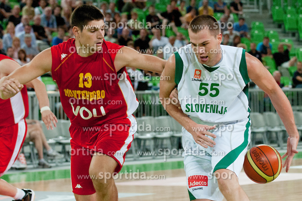 Uros Slokar of Slovenia and Nikola Vucevic of Montenegro at friendly match between Slovenia and Montenegro for Adecco Cup 2011 as part of exhibition games before European Championship Lithuania on August 7, 2011, in SRC Stozice, Ljubljana, Slovenia. (Photo by Matic Klansek Velej / Sportida)