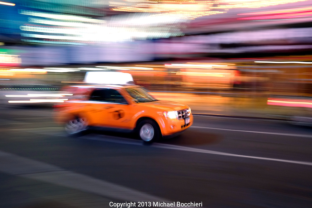 NEW YORK, NY - February 07:  A NYC Taxi drives through Times Square on February 07, 2013 in NEW YORK, NY.  (Photo by Michael Bocchieri/Bocchieri Archive)