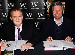 (L-R) Ian Hislop and Nick Newman signing. Private Eye editor Ian Hislop and illustrator Nick Newman sign copies of the Private Eye Annual 2013 and Private Eye: A Cartoon History AT Waterstones, Leadenhall Market, Whittington Avenue, London, United Kingdom. Tuesday, 10th December 2013. Picture by Nils Jorgensen / i-Images