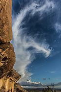Swirling clouds from storm system above sandstone formation in the  New Mexico landscape, © 2012 David A. Ponton