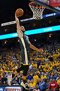 April 30, 2019; Oakland, CA, USA; Golden State Warriors guard Stephen Curry (30) dunks the basketball against the Houston Rockets during the fourth quarter in game two of the second round of the 2019 NBA Playoffs at Oracle Arena. The Warriors defeated the Rockets 115-109.