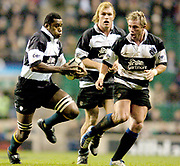 2004_'The Gartmore Challenge' - Barbarians_vs_New-Zealand..left to right Sireli Bobo - Schalk Burger and Justin Marshall..04.12.2004 Photo  Peter Spurrier. .email images@intersport-images.com...