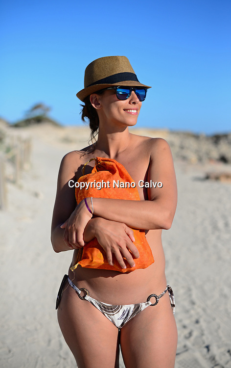 Attractive young woman on the beach in Ibiza, Balearic Islands, Spain