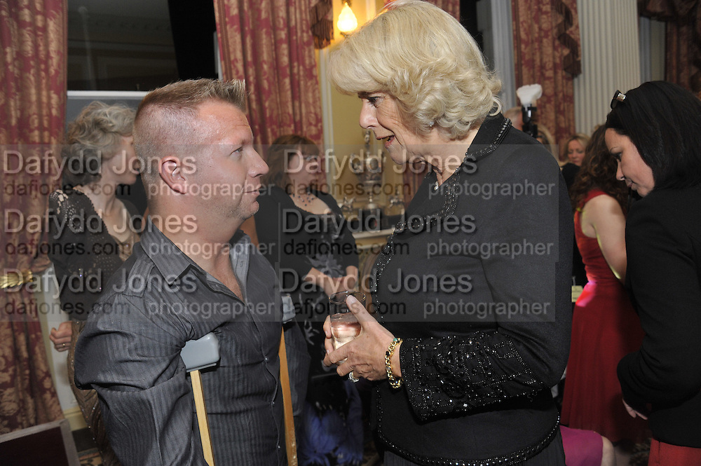 LEE PEARSON; CAMILLA DUCHESS OF CORNWALL, The Lady Joseph Trust, fundraising party.<br /> Camilla, Duchess of Cornwall  attends gala fundraising event as newly appointed President of the charity. The Lady Joseph Trust was formed in 2009 to raise funds to acquire horses for the UK's top Paralympic riders Cavalry and Guards Club, 127 Piccadilly, London,<br /> 26 October 2011. <br /> <br />  , -DO NOT ARCHIVE-© Copyright Photograph by Dafydd Jones. 248 Clapham Rd. London SW9 0PZ. Tel 0207 820 0771. www.dafjones.com.