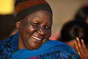 A South Sudanese Dinka refugee woman takes part in  International Migrants Day celebration organized by UNHCR partner agency IOM December 16 2017 in the Maadi district of Cairo, Egypt. The International Migrants Day celebration included free activities for children, cultural and musical performances, and free medical and dental screenings along with booths by local refugee NGO's and a craft marketplace.
