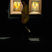 MILAN, ITALY - SEPTEMBER 21:  A woman walks in front of two oil paintings by Salvador Dali at the Exhibition preview at Palazzo Reale on September 21, 2010 in Milan, Italy. Dali is back in Milan with Il sogno si avvicina, an exhibition that takes place at Palazzo Reale  and that focus on the relationship between the great Spanish artist's visions and his favourite themes:  landscape, dream and desire.