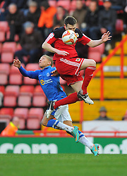 Bristol City's Stephen McManus battles for the high ball with Peterborough United's Dwight Gayle - Photo mandatory by-line: Joe Meredith/JMP  - Tel: Mobile:07966 386802 29/12/2012 - Bristol City v Peterborough United - SPORT - FOOTBALL - Championship -  Bristol  - Ashton Gate Stadium -