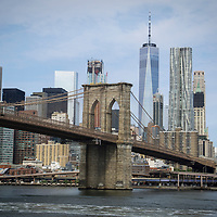A general view of the Brooklyn Bridge and downtown New York City Skyline from the East River. Manhattan, New York, NY USA