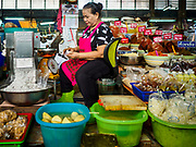 28 MAY 2018 - BANGKOK, THAILAND: A stand selling pickled produce and curry paste in Phra Khanong Market in Bangkok. The market serves a mix of Thai working class people and immigrants from Myanmar (Burma).     PHOTO BY JACK KURTZ