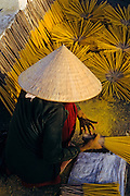 VIETNAM, INCENSE MAKING woman collected dried incense  sticks
