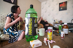 A bottle of strong cider on a table with a box of Fluoxetine (Prozac), an antidepressant.