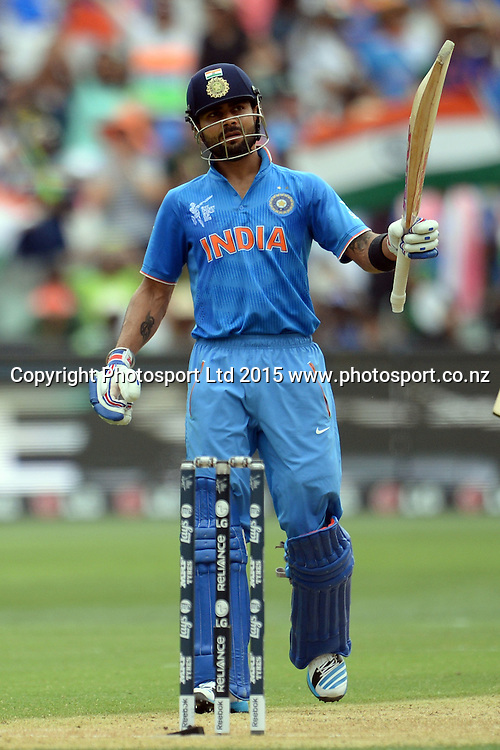 Indian batsman Virat Kohli celebrates his fifty during the ICC Cricket World Cup match between India and Pakistan at Adelaide Oval in Adelaide, Australia. Sunday 15 February 2015. Copyright Photo: Raghavan Venugopal / www.photosport.co.nz