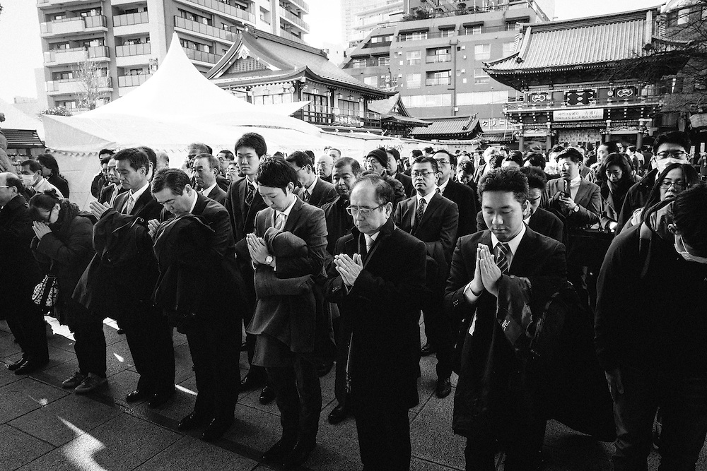 TOKYO, JAPAN - JANUARY 4 : Japanese businessmen pray for prosperity of their firms during a New Year's ceremony at Kanda Myojin Shrine in downtown Tokyo, on the first business day of the year Wednesday, January 4, 2017. (Photo by Richard Atrero de Guzman/NURPhoto)