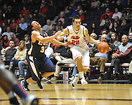 """Ole Miss' Marshall Henderson (22) fouls East Tennessee State's Mario Stramaglia (3) at the C.M. """"Tad"""" Smith Coliseum in Oxford, Miss. on Saturday, December 14, 2012. Mississippi won 77-55 to improve to 7-1. (AP Photo/Oxford Eagle, Bruce Newman).."""